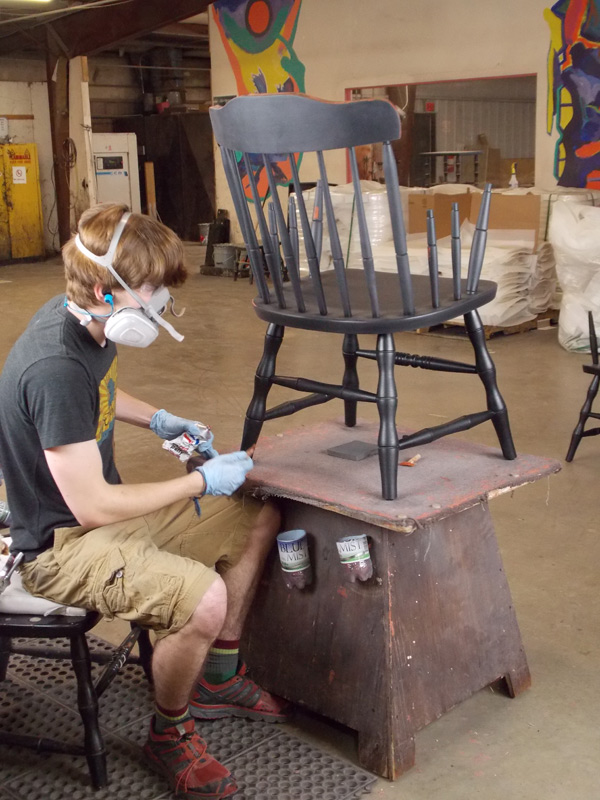 applying final coat to awards chair